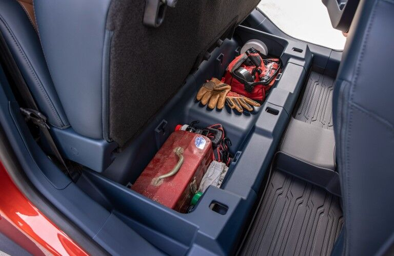 The under-seat storage in the backseat of the 2022 Ford Maverick.