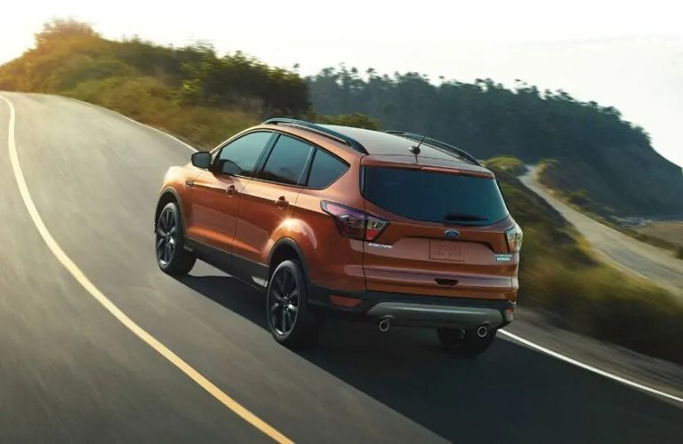 Exterior view of the rear of an orange 2020 Ford Escape