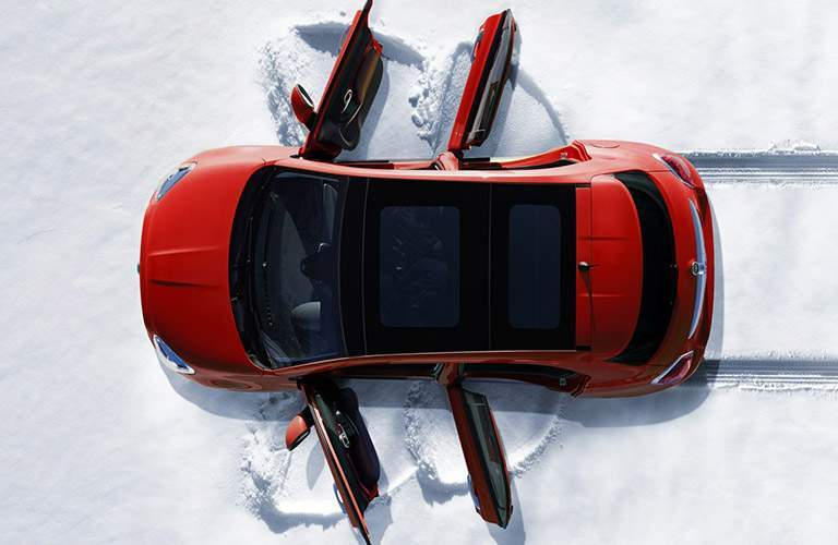 Top view of Fiat 500x parked on snow-covered terrain with all four doors open
