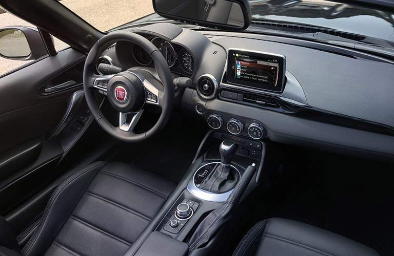 Two seats and gear shifter inside 2018 Fiat 124 Spider
