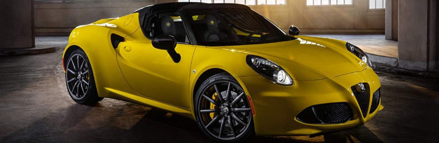 Yellow 2018 Alfa Romeo 4C parked in warehouse