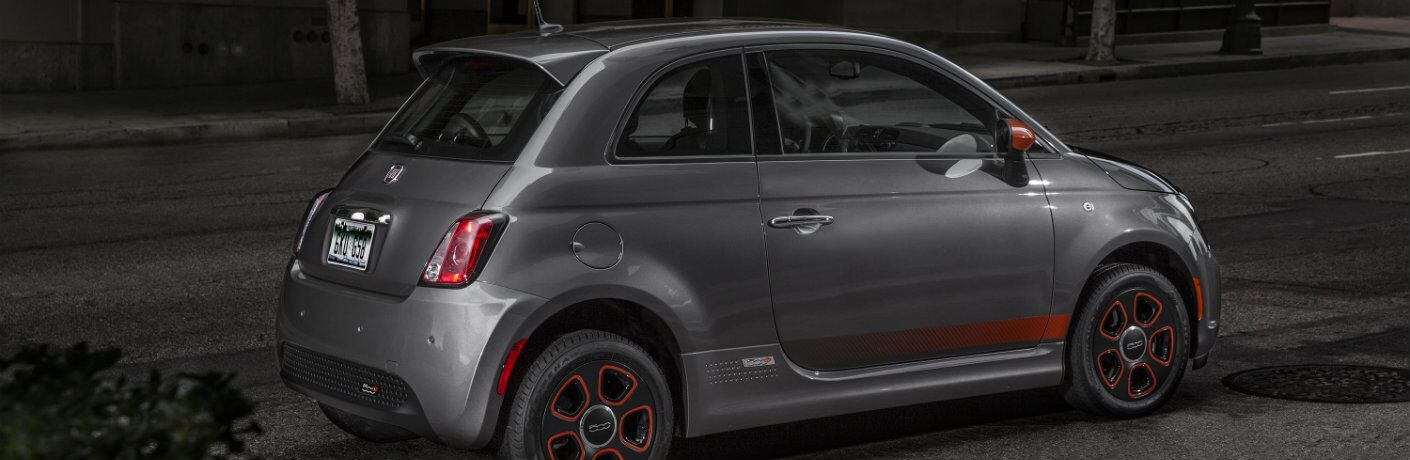 Profile view of gray 2018 Fiat 500e parked on dark street