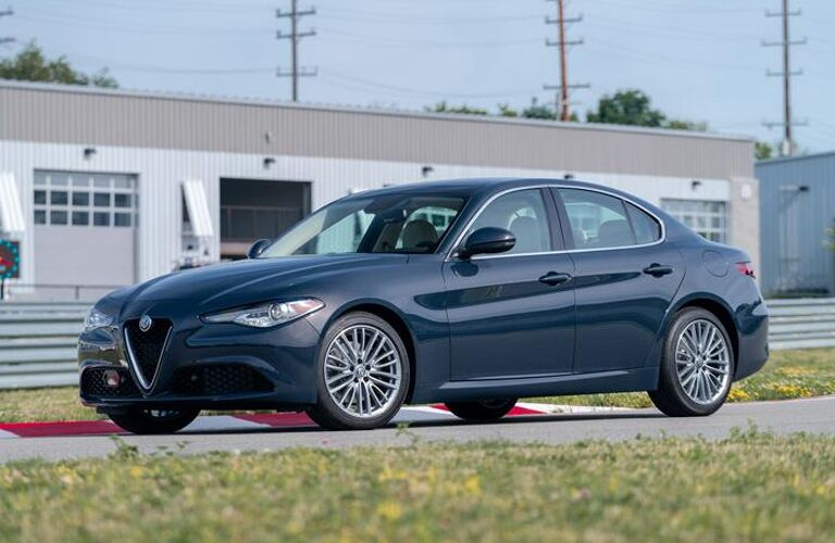 side view of blue 2019 alfa romeo giulia