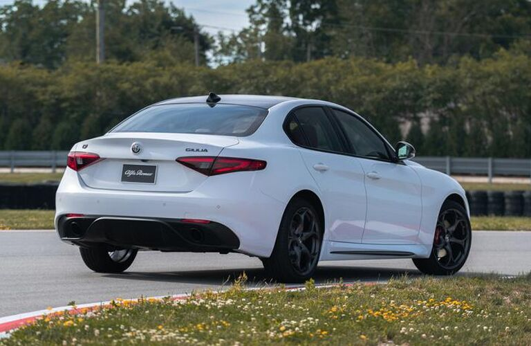 rear and side view of white 2019 alfa romeo giulia