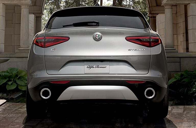 2019 Alfa Romeo Stelvio exterior rear shot with gray paint color showing back bumper, trunk, and taillight design