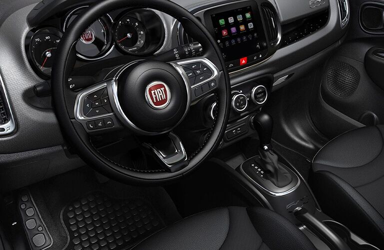 front interior of 2019 fiat 500l including steering wheel and infotainment system