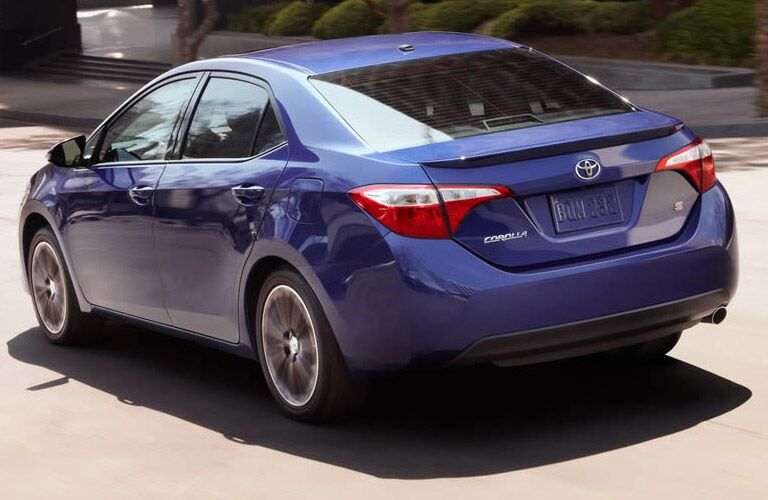 Rear view of blue 2015 Toyota Corolla