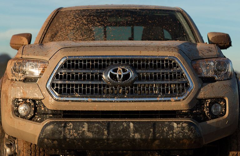 Front view of muddy 2016 Toyota Tacoma