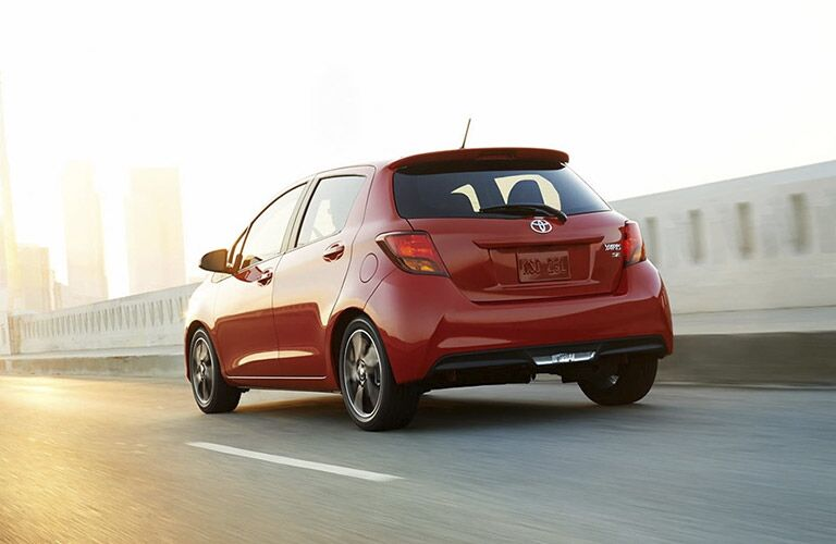 Red 2016 Toyota Yaris driving