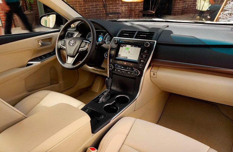 2017 Toyota Camry two tone interior with infotainment center and steering wheel