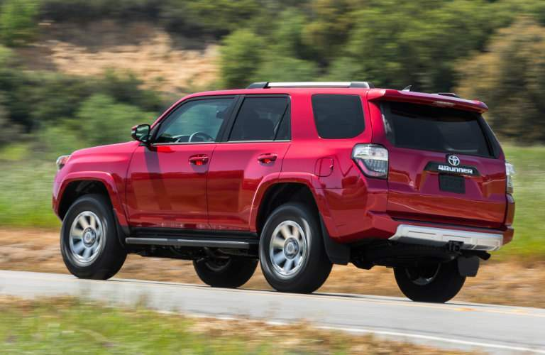 2018 Toyota 4Runner driving on highway exterior rear driver side view