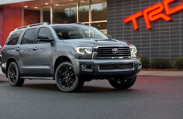 2018 Toyota Sequoia Front View of Gray Exterior in Front of TRD Sign