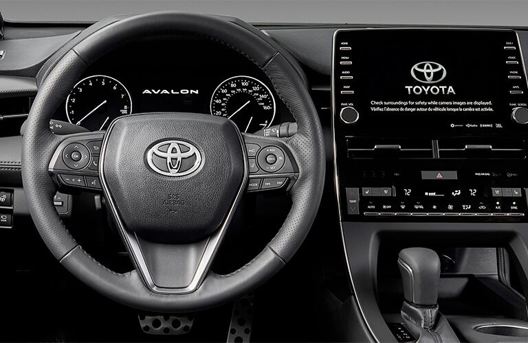 Steering wheel and touchscreen inside 2019 Toyota Avalon