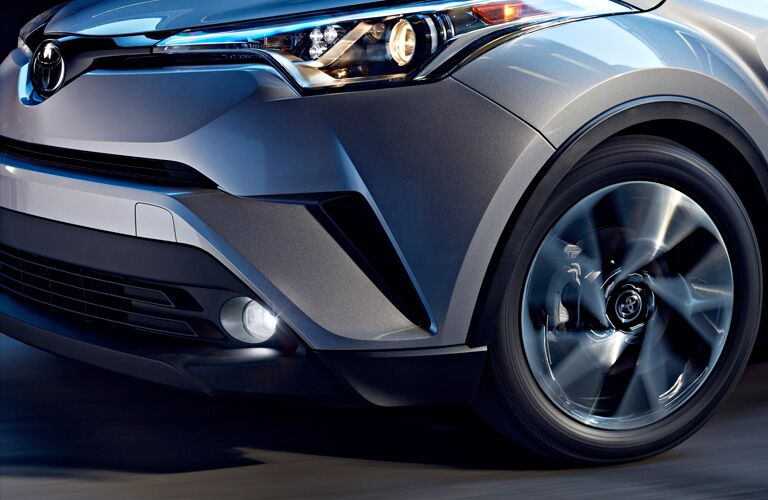 2019 Toyota C-HR Close-up View of Headlight and Spinning Front Wheel