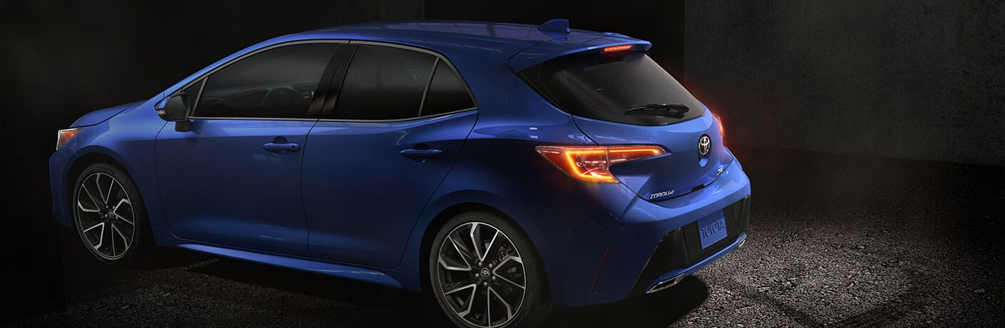 2019 Toyota Corolla Hatchback Side View of Blue Exterior with Dark Background