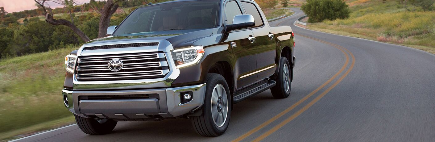 Black 2019 Toyota Tundra driving on country road