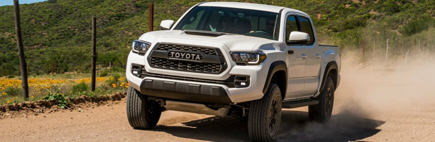 2019 Toyota Tacoma TRD Pro driving on dirt road