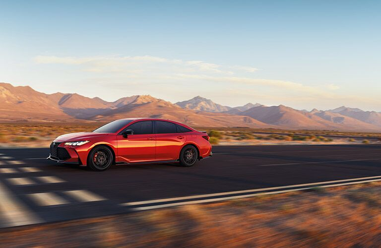 Side view of red 2020 Toyota Avalon driving