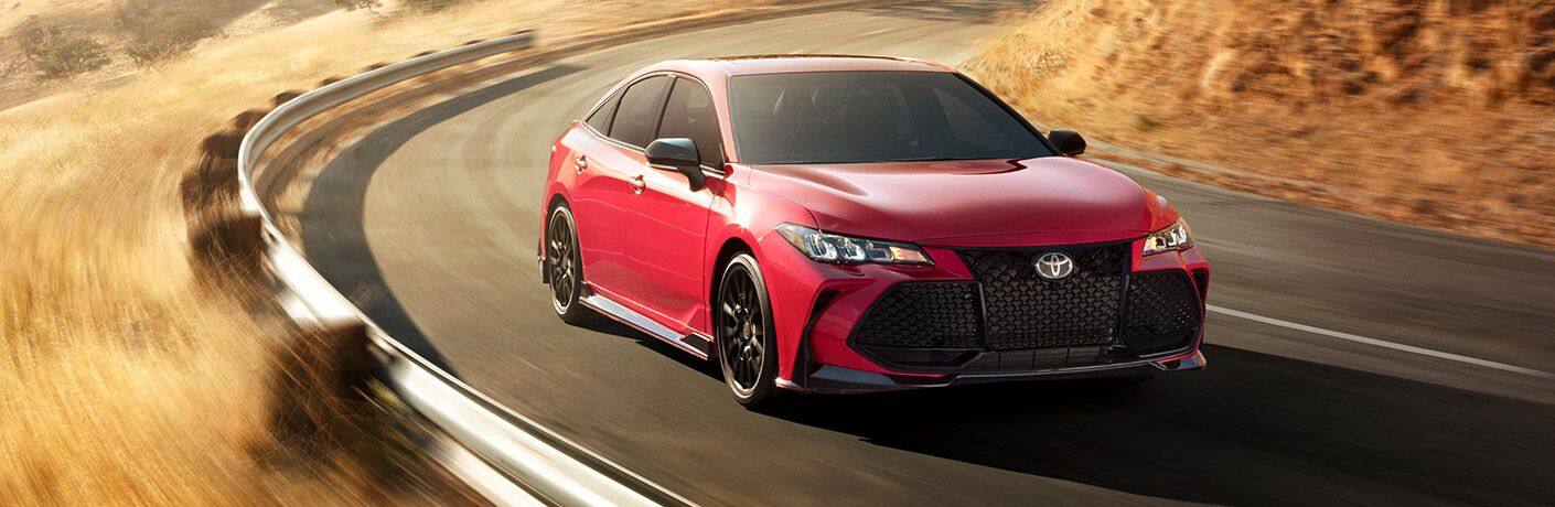 Red 2020 Toyota Avalon driving