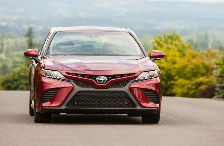 Front profile of a red 2020 Toyota Camry Hybdrid