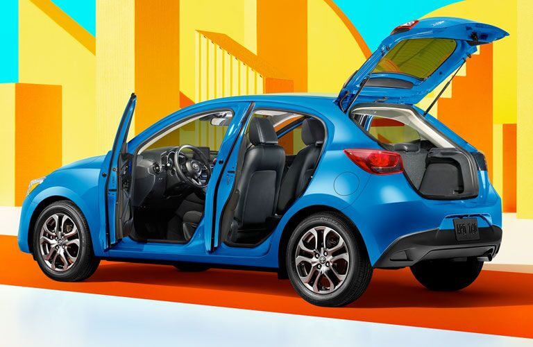 Blue 2020 Toyota Yaris Hatchback with trunk and doors open