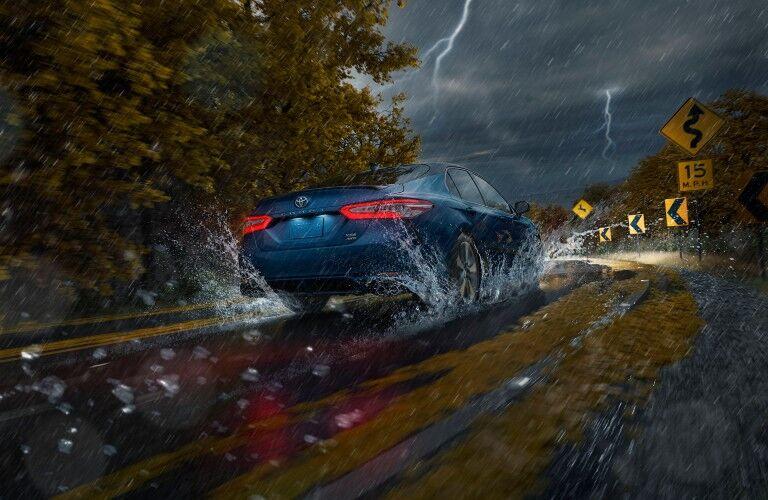 Blue 2020 Toyota Camry AWD in rain