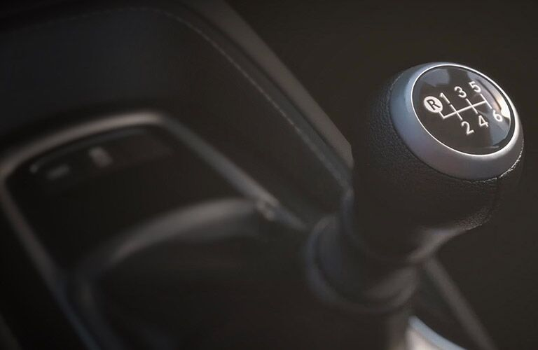 A close up photo of the gear shifter for the the standard six-speed manual transmission in the 2019 Toyota Corolla Hatchback.