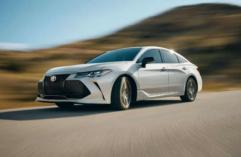A front left quarter photo of the 2020 Toyota Avalon on the road.