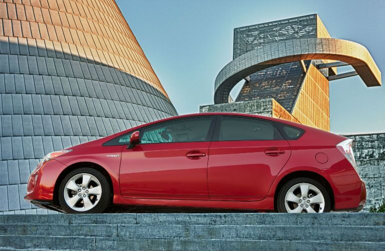 A left profile photo of a certified pre-owned Toyota Prius.