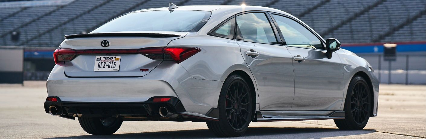 A rear right quarter photo of the 2020 Toyota Avalon parked at a race track.