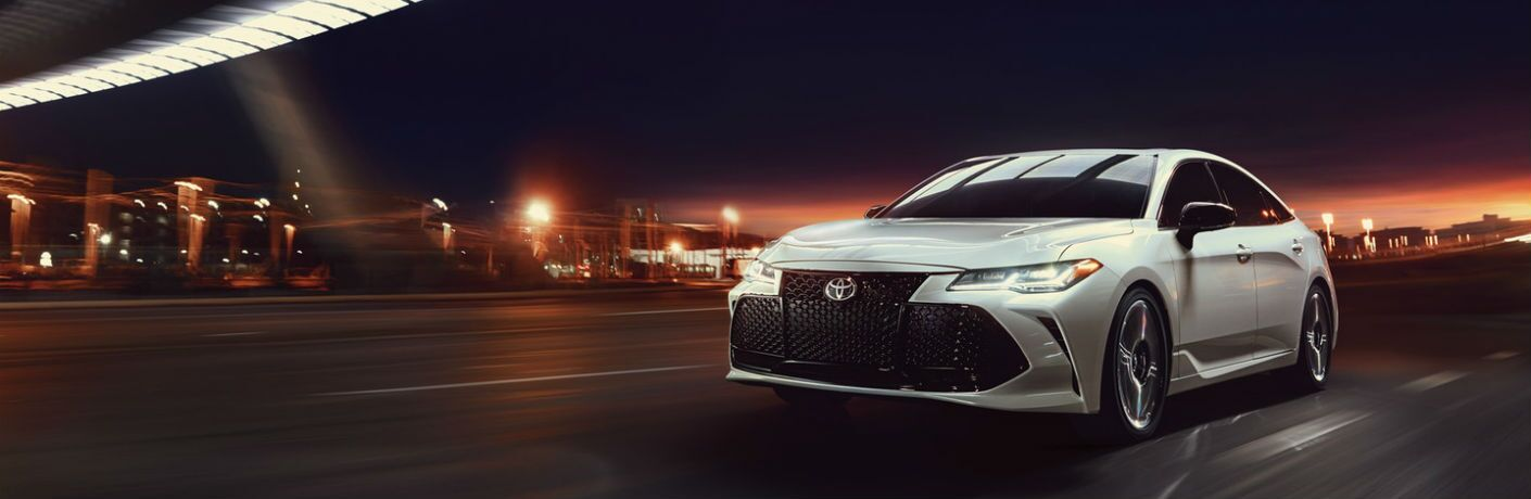 A front left quarter photo of the 2020 Toyota Avalon in motion on the road.