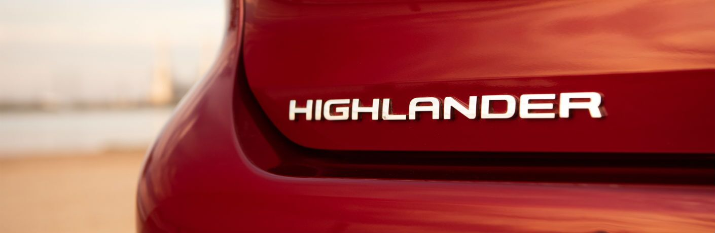A close up photo of the Highlander badge on the back of the 2020 Toyota Highlander Hybrid.