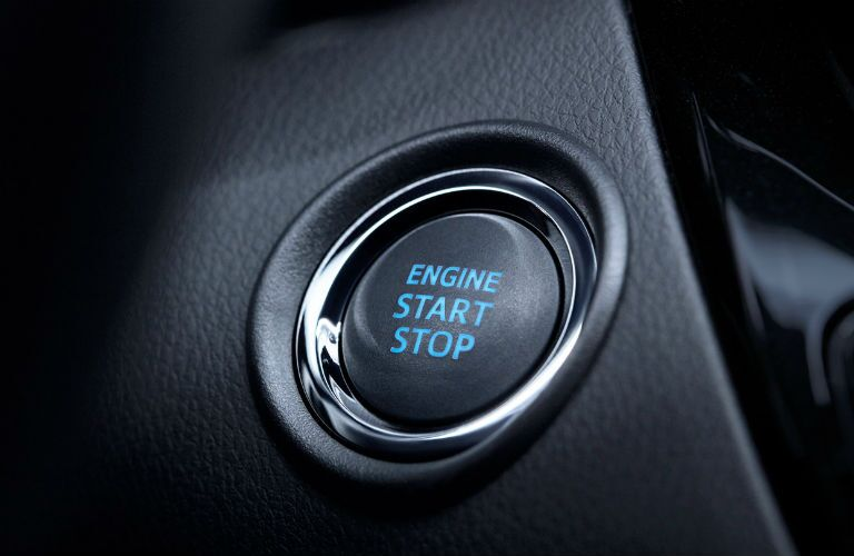 A photo of the keyless ignition button in the 2020 Toyota C-HR.