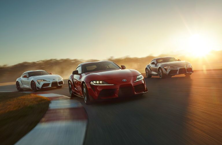 A photo of three 2020 Toyota Supra models on a race track.