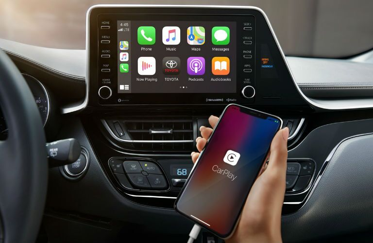 A photo of the a phone being connected to the infotainment system in the 2020 Toyota C-HR.