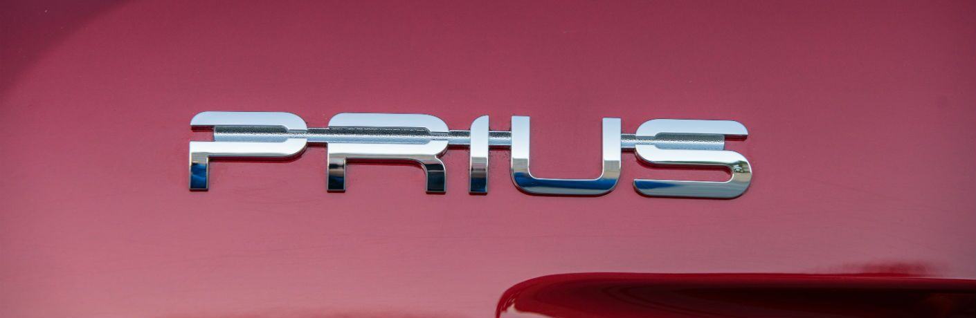 A photo of the Prius badge used on a certified pre-owned Toyota Prius.