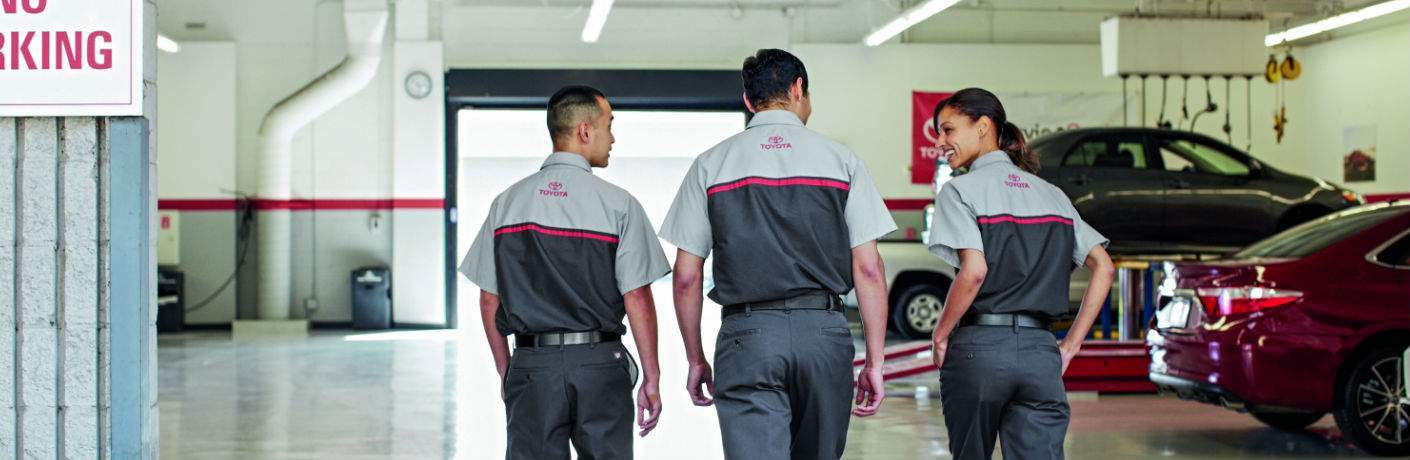 Three Toyota Service Technitians in a Service Department