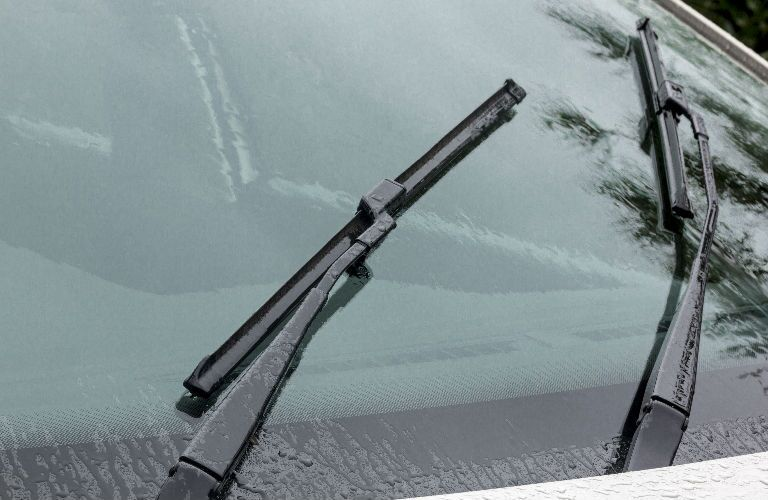 Wiper Blades on Exterior of Vehicle in Rain