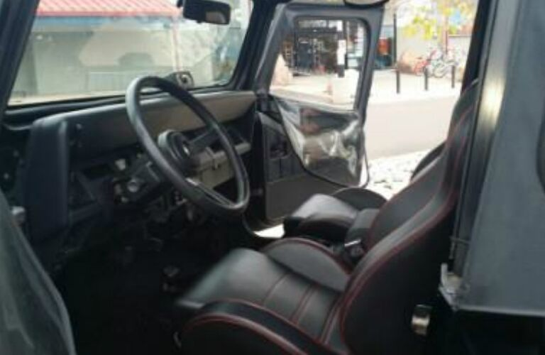 Dashboard and Red and Black Seats of 1993 Jeep Wrangler Sahara