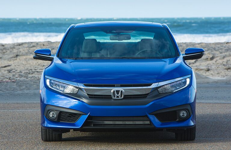 front view of a blue 2018 Honda Civic Coupe