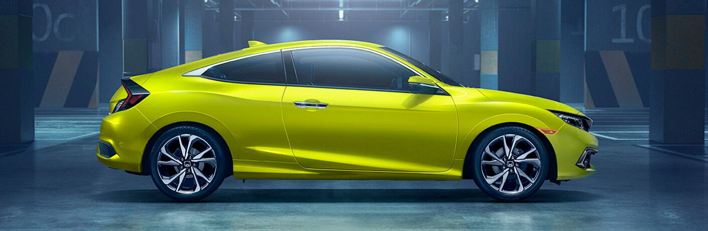 side view of a yellow 2019 Honda Civic Coupe