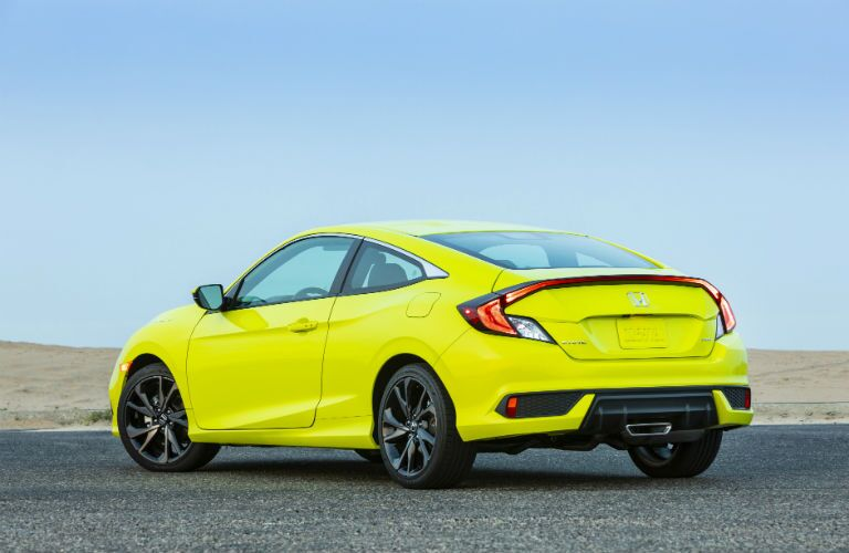 rear view of a yellow 2019 Honda Civic Coupe Sport