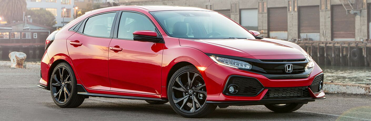 side view of a red 2019 Honda Civic Hatchback