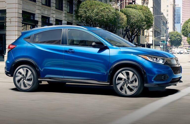 Side view of a blue 2020 Honda HR-V in a city.