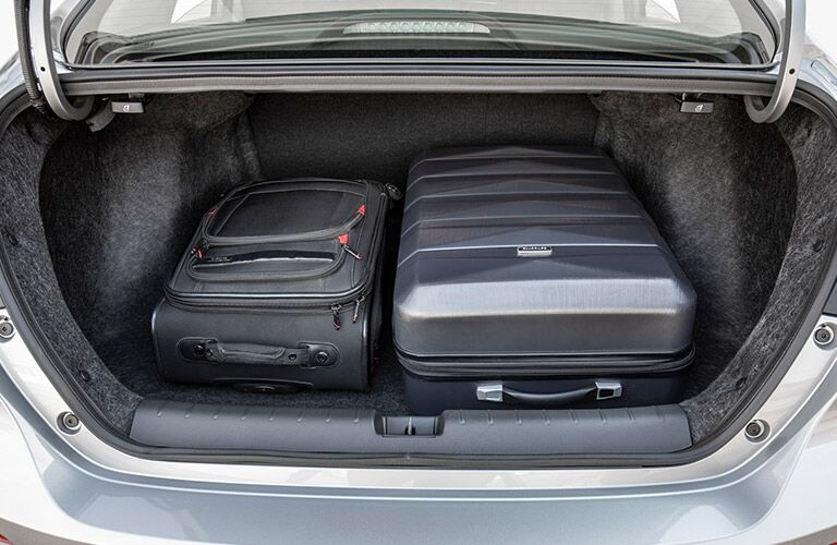 open trunk of a 2019 Honda Insight with two suitcases in it
