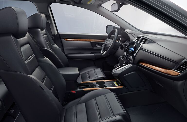Side view of the front seats inside a 2020 Honda CR-V.