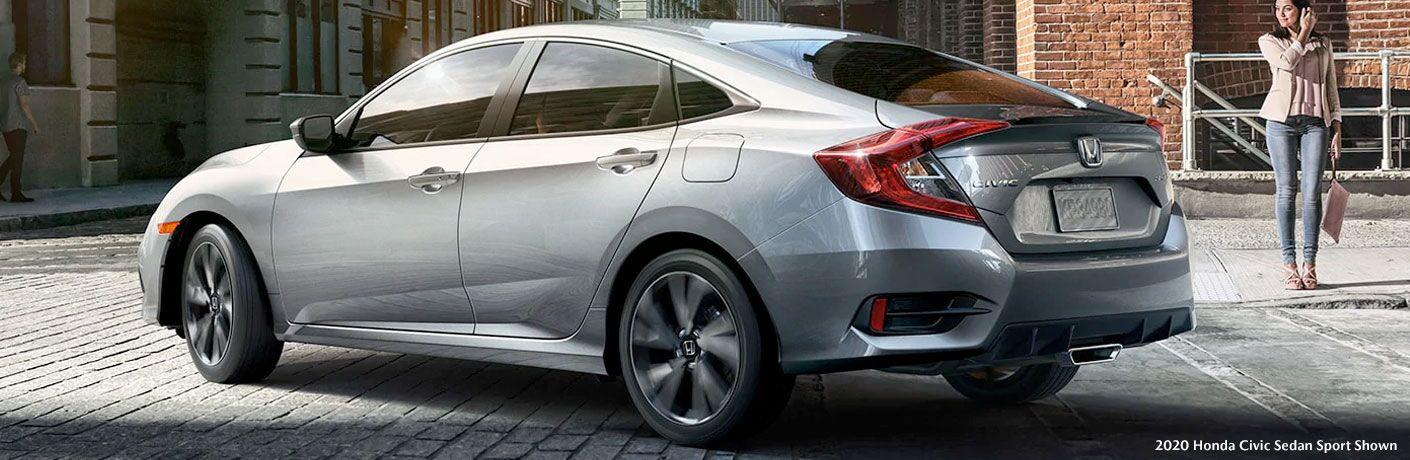 Silver 2020 Honda Civic sedan turns a corner in a city.
