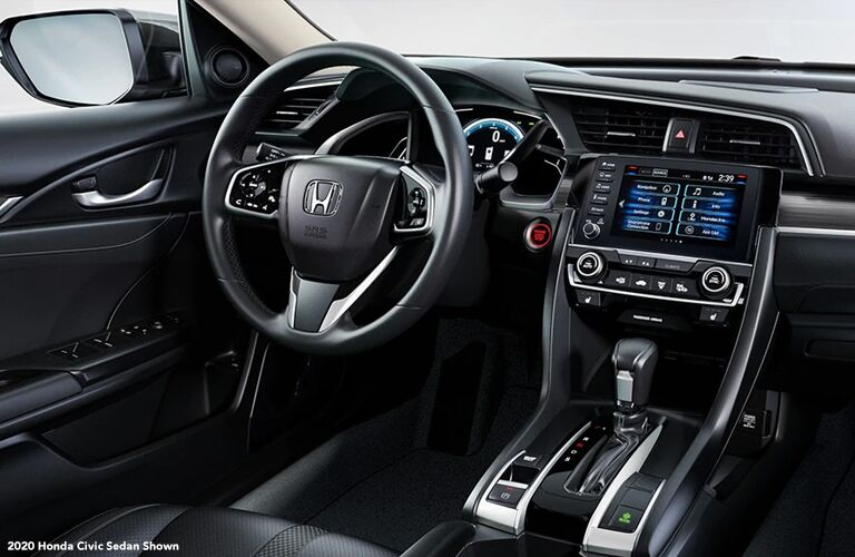 Interior front driver's cabin in a 2020 Honda Civic Sedan.
