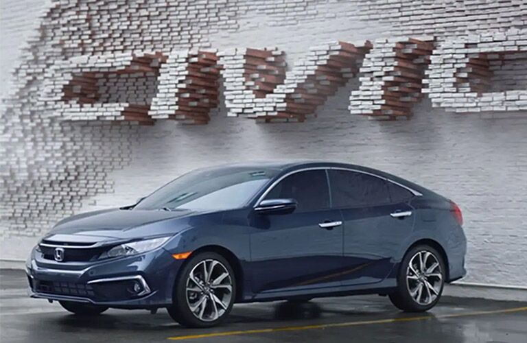 2021 Honda Civic in front of big Civic letters