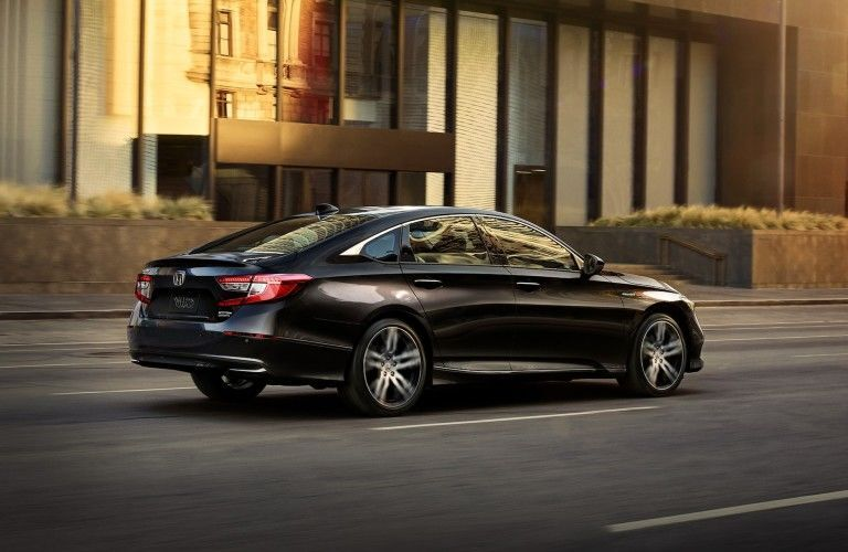 Rear/side view of 2021 Honda Accord driving down city street